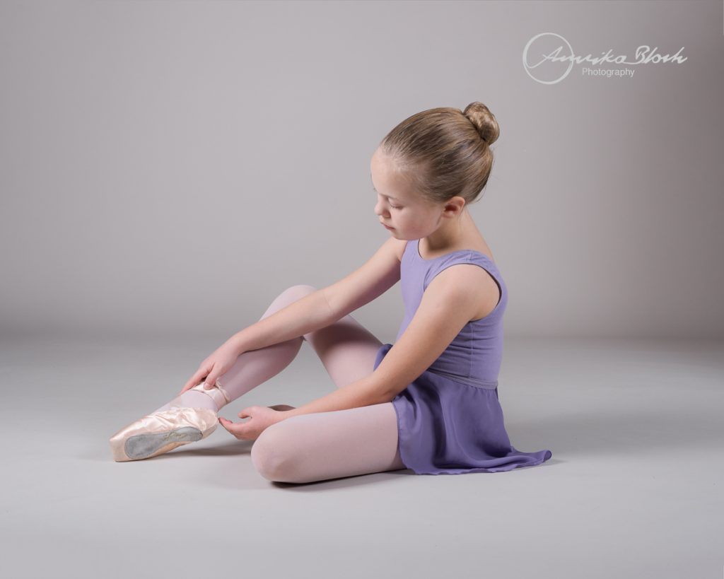 A young girl getting ready for her ballet photography session in West London